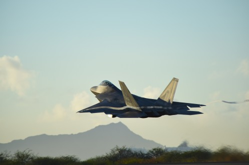 A F-22 Raptor, from the 199th Fighter Squadron, increases altitude shortly after taking off from Joint Base Pearl Harbor-Hickam, Hawaii, June 6, 2015. Pilots of the F-22 from the Hawaii Air National Guard's 199th Fighter Squadron and the 19th Fighter Squadron teamed up with maintenance Airmen from the 154th Wing and 15th Maintenance Group to launch and recover 62 Raptors in a day. The previous record was 46 sorties in one day with 14 aircraft, this recorded was broken using only 12 of the 18 aircraft in the smallest F-22 squadron in the Air Force. (U.S. Air Force photo by Tech. Sgt. Aaron Oelrich/Released)