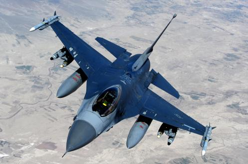 """An F-16 Fighting Falcon, from the 555th Fighter Squadron also known as """"Triple Nickel,"""" Aviano Air Base, Italy, moves away after receiving fuel from a KC-135 Stratotanker, assigned to the 340th Expeditionary Air Refueling Squadron, over Afghanistan in support of Operation Enduring Freedom, March 29."""
