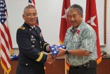 BG Tamashiro presents Gerald Takase with his flag