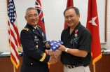 BG Tamashiro presents Winston Ling with his flag