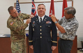 Lopina pinned by MG Logan and Maj Gen (Ret) Wong