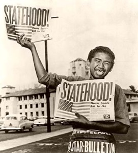 Star-Bulletin photographer Albert Yamauchi captured this image of news carrier Chester Kahapea selling copies of the Honolulu Star-Bulletin on the day Hawaii became the 50th State. August 21, 1959. This photo epitomizes the joy and excitement of the day Hawaii became the last star on the US flag.