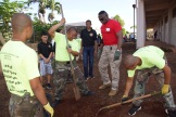 "Hawaii National Guard Youth Challenge Academy Cadets dig holes to plant shade trees at Campbell High School. SMG-R Juan ""JD"" Williams, YCA director provides working mentorship to the Cadets."