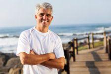 active-mid-age-man-sportswear-beach-30944935
