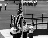 The American flag is flown July 29, 1986, during the first reveille of Air Force NCO academy class 86-3 at the I.G. Brown Training and Education Center in Louisville, Tenn. The event closed a 16-year journey to fly over the capitols of every state and territory in the United States. It was sent out by NCO academy class 71-1. (U.S. Air National Guard file photo/released)