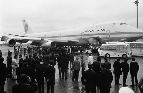 a crowd is gathered at London's Heathrow Airport in England after a Pan Am Boeing 747 Jumbo Jet arrived in from New York. The 360 seat jet was the first of its kind to complete a transatlantic crossing. For decades, the Boeing's 747 was the Queen of the Skies. But the glamorous double-decker jumbo jet that revolutionized air travel and shrunk the globe could be nearing the end of the line. (AP Photo, File)