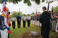 Brig. Gen. Keith Y. Tamashiro, Hawaii Army National Guard commander; Col. Gregory M. Scrivner, Hawaii Air National Guard director of staff; Col. Stephen F. Logan, HIARNG chief of staff and Col. Moses Kaoiwi Jr., 29th Infantry Brigade commander and director of Joint Staff, bow during the ceremonies held at the gravesite of American Civil War veteran J.R. Kealoha. Also at the Oahuu Cemetery grave side are Rev. Curt Kekuna (Kawaiahao Church pastor), HIANG Ceremonial Royal Guardsmen, Hawaii Civil War Round Table reenactors, and members of the Royal order of Kamehameha I, Hawaii Chapter.